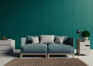 Canapé devant mur papier peint bleu Genève